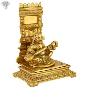 """Photo of Raghavendra Swamy playing veena in front of the Brundavanam-8""""-facing Left side"""